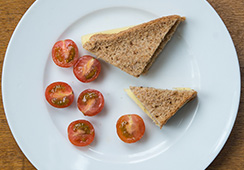 Cheese sandwich (¾ slice wholemeal bread), 3 cherry tomatoes halved