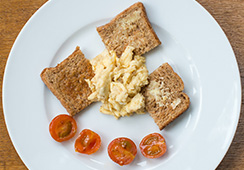 ¾ slice wholemeal toast, 3 tablespoons scrambled egg, 2 cherry tomatoes halved
