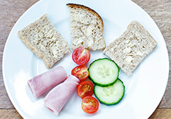 ¾ medium slice bread, 1 small slice of ham, 2 cherry tomatoes, 2 small slices cucumber