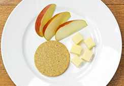 1 oatcake, ¼ medium apple, 15 grams cheese cubes